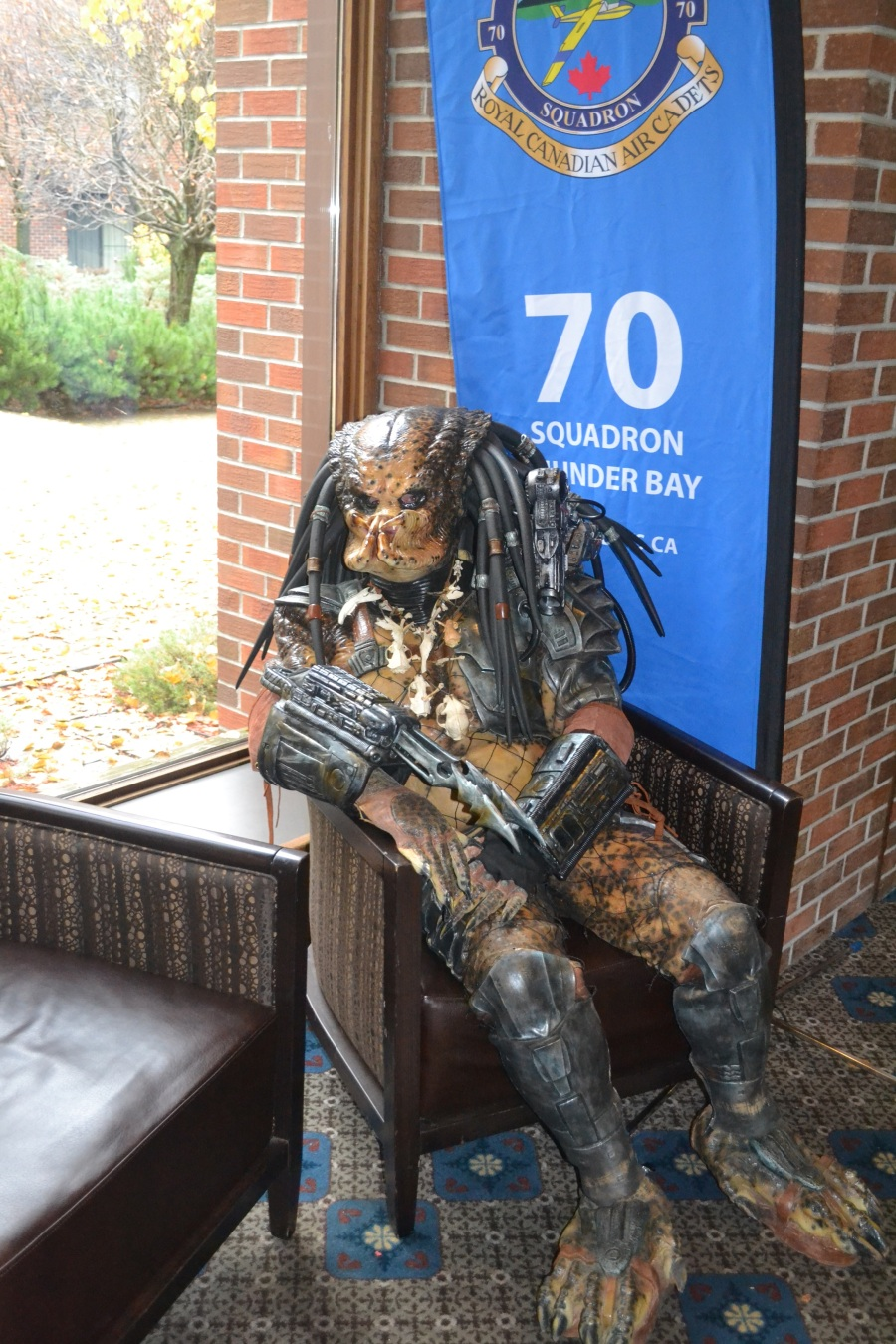 Predator lounging in a chair